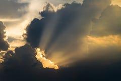Sun rays through cloud Stock Images