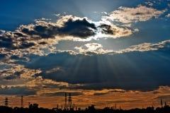 The sun rays through the cloud Stock Photography