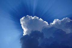 Sun rays. Cloud, blue sky, sun rays Royalty Free Stock Images
