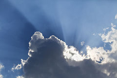 Sun rays through a cloud Stock Images