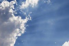 Sun rays through a cloud Stock Images