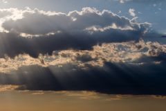 Sun rays and clouds Royalty Free Stock Image