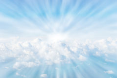 Sun rays in the clouds. White fluffy clouds from heaven sun rays Royalty Free Stock Images