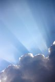Sun rays through clouds. Sun rays filtering through some grey clouds Royalty Free Stock Photography