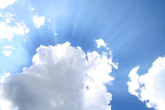 Sun rays through clouds. Sun rays passing through clouds Royalty Free Stock Photography