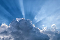Sun rays through the clouds Stock Image