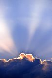 Sun rays through the clouds Stock Images