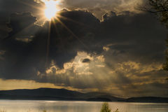 Sun rays from the clouds. On Lipno lake Stock Images