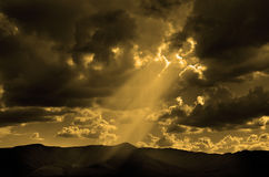 Sun Rays In Clouds and Mountains Stock Photography