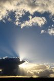 Sun Rays and Clouds Stock Photography