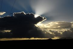 Sun Rays and Clouds Stock Image