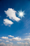 Sun rays and clouds on sky Stock Photography