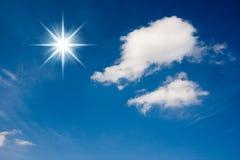 Sun rays and clouds on sky Stock Photos