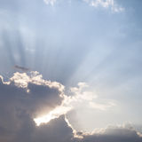 Sun rays through the clouds Royalty Free Stock Image