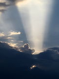 Sun rays coming from sun hidden behind clouds Royalty Free Stock Photography