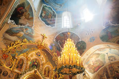 Sun rays coming throuth window on icons in Russian Orthodox church stock image