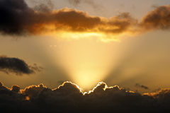 Sun rays and dark clouds Royalty Free Stock Image
