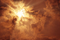 Sun rays with dark clouds Royalty Free Stock Images