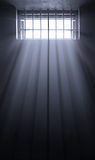 Sun rays in dark prison cell Stock Photo