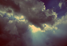Sun rays on dramatic sky - vintage retro style Royalty Free Stock Photo