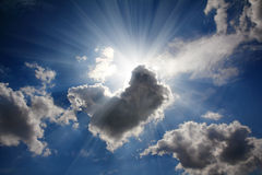 Sun rays on dramatic sky. Wth clouds Stock Images
