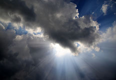 Sun rays on dramatic sky Royalty Free Stock Image