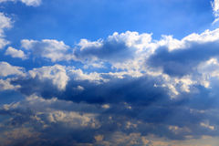 Sun rays falling throw the clouds Stock Photo