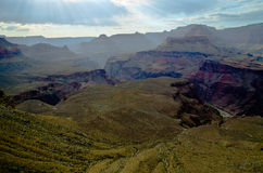 Sun rays during hiking in Grand Canyon. Sun shines through clouds at Grand Canyon, Seen from Bright Angel trail to the bottom Stock Photo