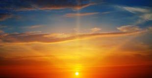 The sun rays illuminate the sky. Above the horizon stock images