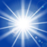Sun rays and light effects on blue sky. Royalty Free Stock Photo