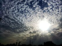 Sun Rays and many clouds royalty free stock photos