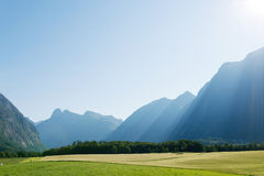 Sun rays in mountains lighting the valley, Norway Stock Photography