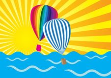 Sun Rays, Ocean and Hot Air Balloons Stock Photography