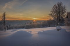 Sun rays in orange winter mountain landscape Royalty Free Stock Images