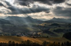 Sun rays over autumn country. Cloudscape at sky. Region Orava, Slovakia royalty free stock image