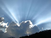 Sun rays over a cloud Royalty Free Stock Photo