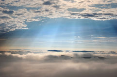Sun rays over the clouds Royalty Free Stock Image