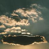 Sun Rays Over Clouds Stock Images