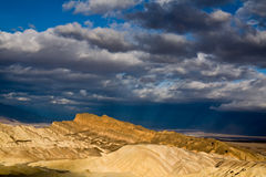 Sun Rays over Death Valley. Sun beams through the clouds at Zabriskie Point in Death Valley, California stock image