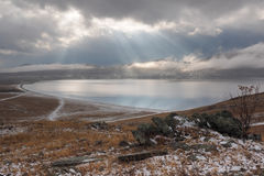 Sun rays over lake Stock Images