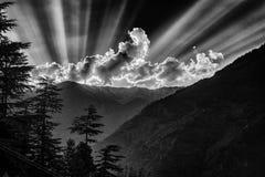 Sun rays over mountains. Black and white Stock Photos