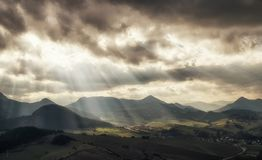 Sun rays over rural country. Sun rays and cloudscape over rural country. Cloudscape at sky. Region Orava, Slovakia stock image
