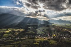 Sun rays over rural country. Sun rays and cloudscape over rural country. Cloudscape at sky. Region Orava, Slovakia. Hill Choc in clouds royalty free stock photography
