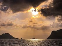 Sun Rays over Sea With Islands Stock Images