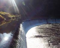Sun rays over the water Stock Photos