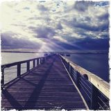 Sun rays on pier Royalty Free Stock Image