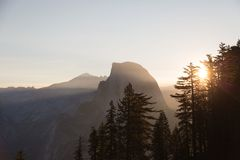 Sun Rays at the Pine Trees and Mountains Royalty Free Stock Images