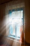 Sun rays pushing through a window Royalty Free Stock Photography