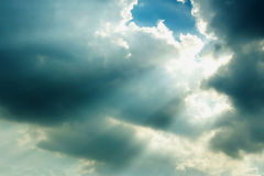 Sun rays through rain clouds Royalty Free Stock Photos