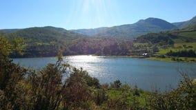 Sun  rays reflection on the lake Stock Photo